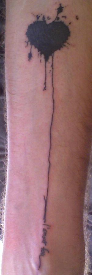 Heart drawing black ink tattoo