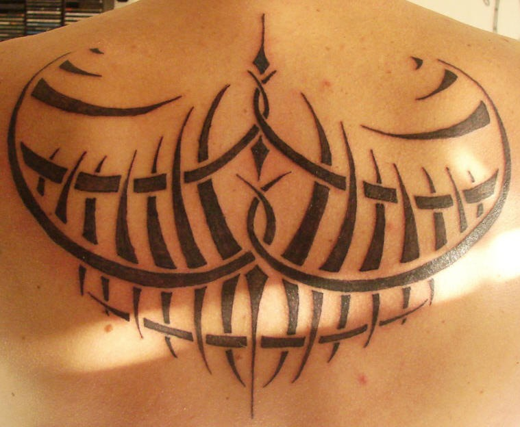 Tribal black tracery tattoo on back