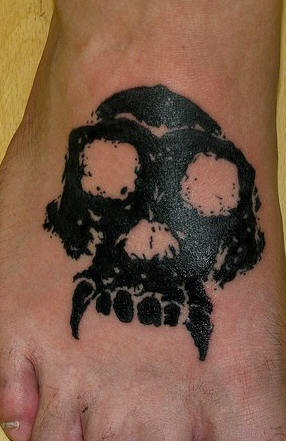 Monkey skull tattoo on feet