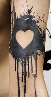 Black splash with white heart tattoo