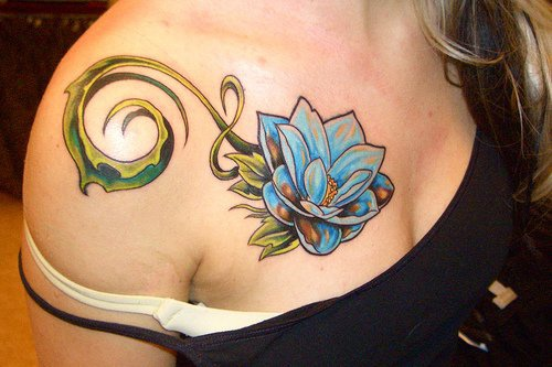 Blue lotus with tracery tattoo on chest