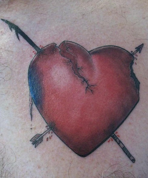 Realistic broken heart tattoo