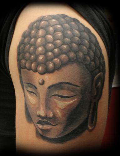 buddista pietra testa nera tatuaggio
