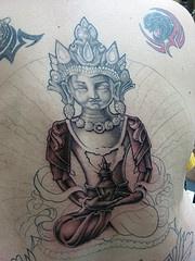 Incomplete buddha statue tattoo