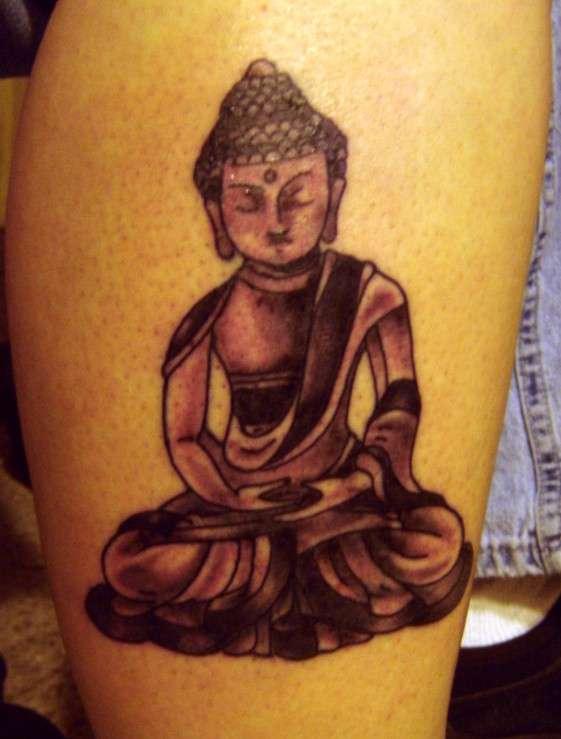 Little meditating buddha tattoo