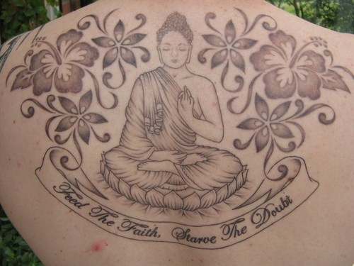 Buddha with flowers full back tattoo