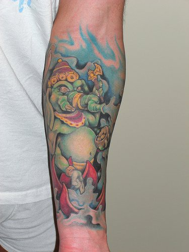 Green ganesha coloured sleeve tattoo