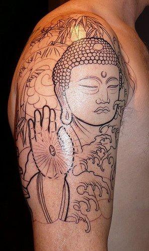 Incomplete buddha statue shoulder tattoo