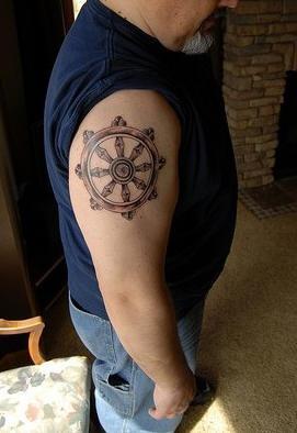 buddista ruota della vita tatuaggio