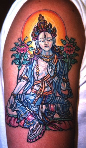 Vishnu deity coloured tattoo on shoulder