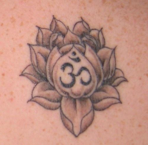 Buddhist mantra in lotus tattoo