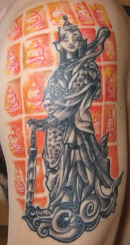 Stone buddhist statue coloured tattoo