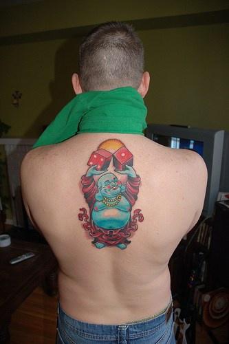 buddhista blu dadi da gioco tatuaggio sulla schiena