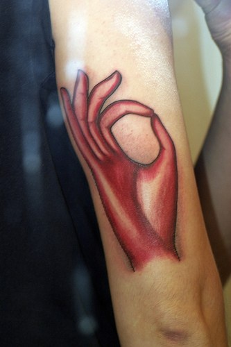 Monk hand red ink tattoo