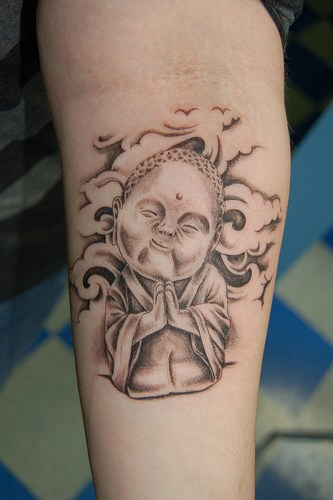 Smiling buddha in clouds black ink tattoo