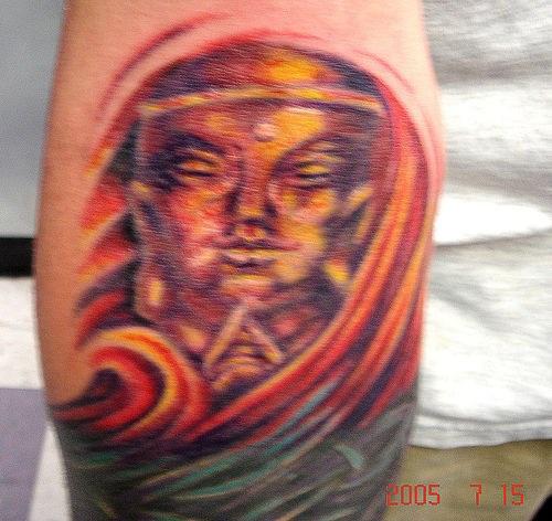 buddha d&quotoro colorato tatuaggio