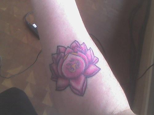Purple buddhist lotus tattoo