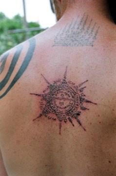 Buddhist symbol with mantra  tattoo