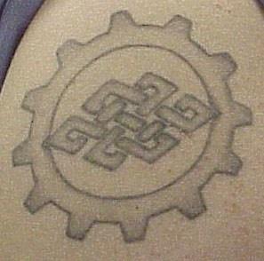 Simple buddhist symbol tattoo