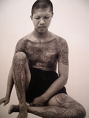 Tibetian buddhist with full body mantra tattoo