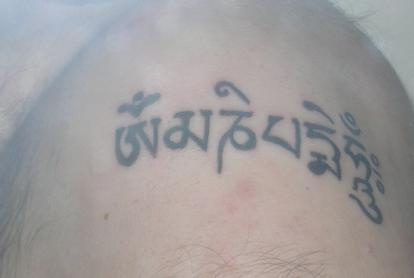 Buddhist hindu writings tattoo
