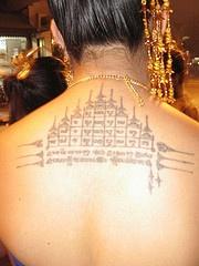 Strange buddhist scheme tattoo on back