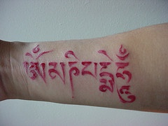 Hindu writings red ink tattoo