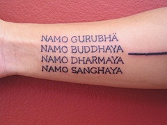 Buddhist mantra text tattoo