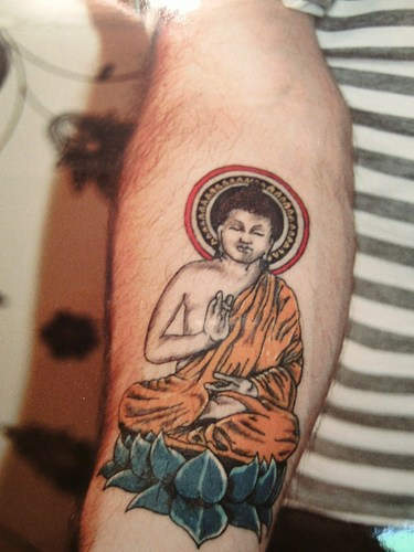Buddha meditating coloured tattoo