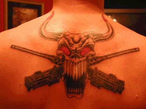 Bull skull and guns tattoo on back