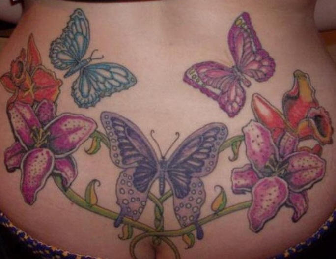 Lower back tattoo,parti-coloured butterfly and flower