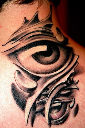 Black tribal tracery with eye