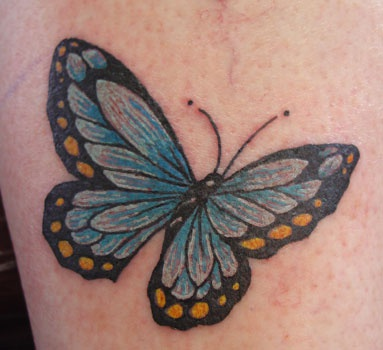 Realistic blue butterfly tattoo
