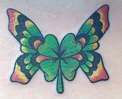 Four leaf clover with butterfly wings  tattoo
