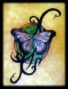 Blue butterfly with tribal tracery coloured tattoo
