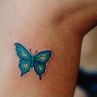 Almost invisible blue butterfly tattoo