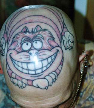 Cartoon cheshire cat tattoo