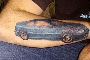 Regular blue sedan car on arm