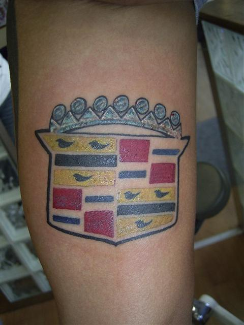 Cadillac logo coloured tattoo