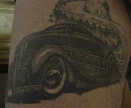 Black roadster on mountain tattoo