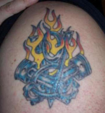 Car engine in flames coloured tattoo