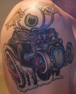 Drag racing car with flying eyeball tattoo
