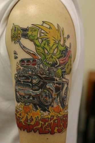 Green orc and black racing car in flames