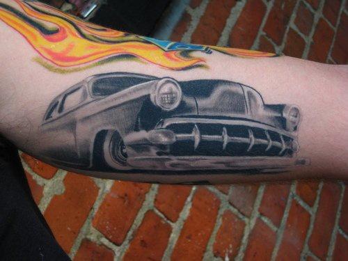 Black roadster arm tattoo