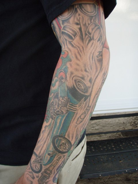 Drag racing car tattoo on arm