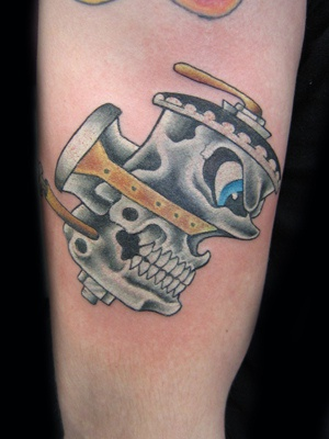 Humanised car engine tattoo