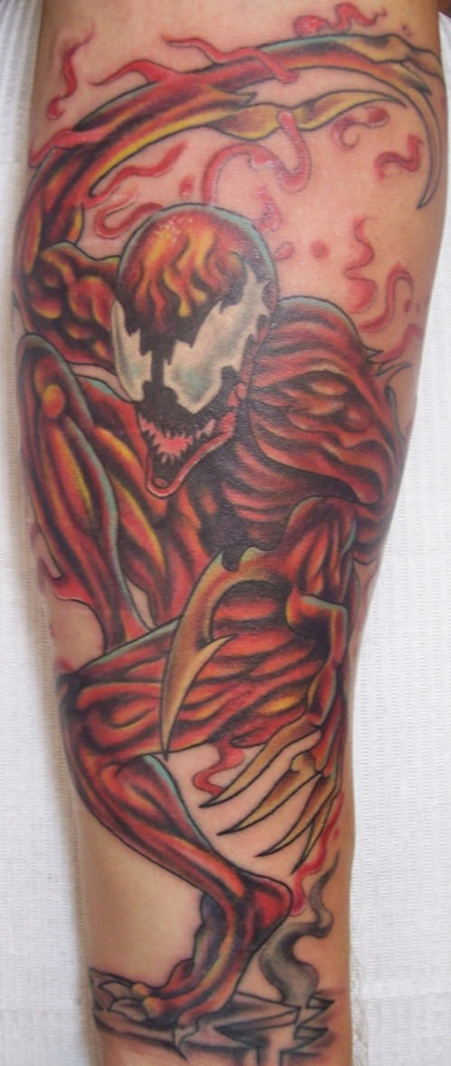 Tall, red ,impudent spiderman in carnage forearm tattoo