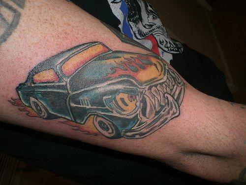 Classic demon car in flames tattoo