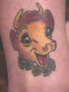 Joyful cartoon cow tattoo