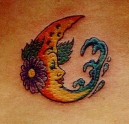 Cartoonish moon and flowers tattoo